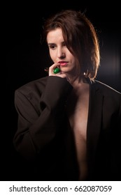 Sexy gorgeous woman wearing a jacket in studio photo on black background. Fashion style.