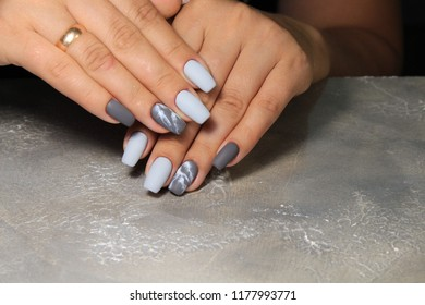sexy gray manicure on a trendy texture background