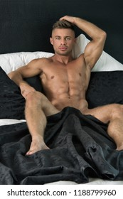 Sexy guy in bed. Relax and rest.