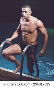 sexy guy in underwear diving in pool