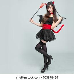 Sexy halloween woman devil , asian girl