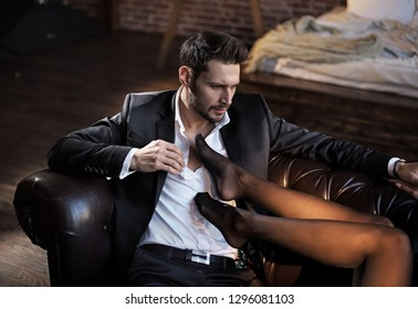 Sexy handsome guy looking on female legs