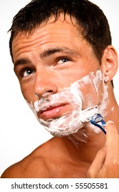 Sexy handsome young man with a shaving foam