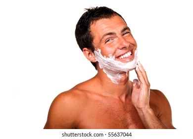 Sexy handsome young man with a shaving foam, smiling
