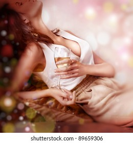 Sexy happy woman with champagne over luxury holiday light background