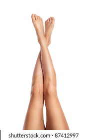 sexy healthy slender female legs isolated on white background