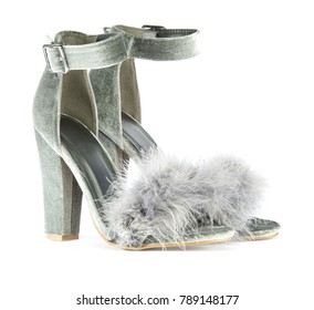 Sexy high heels shoes with ankle strap and fancy faux (fake) fur in gray suede, isolated on white background