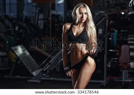Very bikini blonde fitness model with