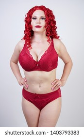 sexy hot curvy girl with red curly hair wearing lace sexy lingerie and high heels in the studio