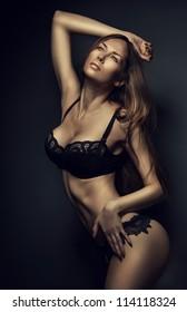 sexy hot woman in black lingerie in dark