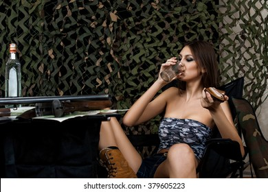 sexy huntress drinks vodka and eats bacon