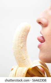 Sexy image of a girl licking a banana