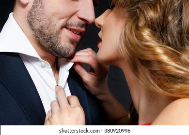 Sexy kissing stylish couple of lovers close up portrait
