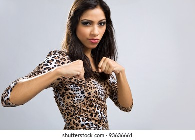 Sexy latin girl in animal print short dress