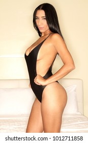 Sexy latina woman in black lingerie bodysuit