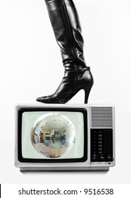 sexy leather boot on tv, with discoball