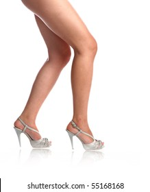 sexy legs of the girl on high heels isolated on white