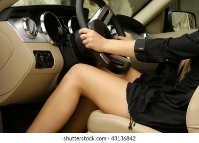Sexy legs in a luxury car