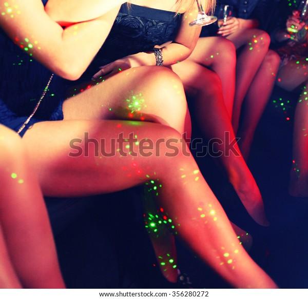 Sexy legs in night club tned image
