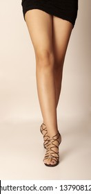 Sexy legs of a woman walking towards camera