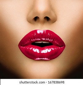 Sexy Lips. Beauty Red Lip Makeup Detail. Beautiful Make-up Closeup. Sensual Open Mouth. lipstick or Lipgloss. Kiss. Beauty Model Woman's Face close-up
