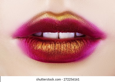 Sexy lips. Beauty red pink gold lips Makeup Detail. Beautiful Make-up Closeup. Sensual Open Mouth.