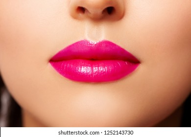 Sexy lips, Make up. Close-up Beauty Fashion Woman Lips. Makeup. Pink shine Lipstick. Filled Beautiful Female Lips Close up. Lipstick Fuchsia Colors lacquered. Big Lip