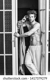 Sexy lover concept. Guy smooth skin wear bathrobe. Beginning of great evening. Man with sexy torso drink wine. Bachelor sexy body. Sexy attractive macho tousled hair coming out through bedroom door.