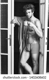 Sexy macho tousled hair coming out bedroom door. Seductive lover full of desire. Man lover near door. Sexy bachelor lover concept. That was great night. Guy attractive lover enjoy morning coffee.