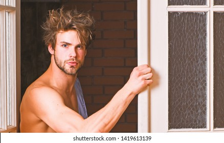 Sexy macho tousled hair coming out bedroom door. Seductive lover full of desire. Man lover near door. Sexy bachelor lover concept. That was great night. Guy attractive lover posing seductive.