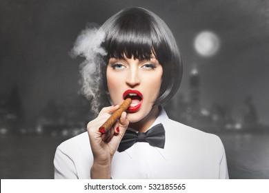 Sexy mafiosi woman boss smoke with cigar in town