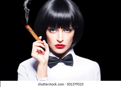 Sexy mafiosi woman with cigar in tuxedo, beauty, isolated on black, mafia