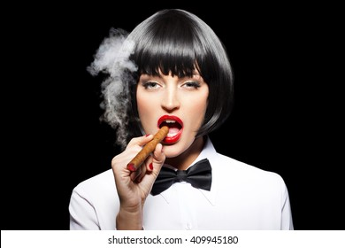Sexy mafiosi woman smoke with cigar, isolated on black