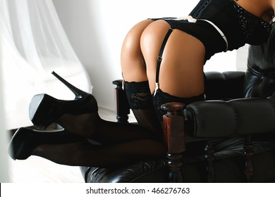 Sexy maid. Hot girl. Luxury ass. Stockings. Slender legs. Game costume. Athletic body. Girl in sexy black lingerie and stockings. Temptation. Silicone implants. Buttocks.
