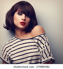 Sexy makeup short hair female model in casual clothes posing. Closeup vintage portrait