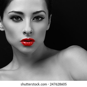 Sexy makeup woman with red lipstick. Black and white portrait. Closeup