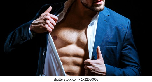 Sexy male body torso in suit. Business man undress suit on black background