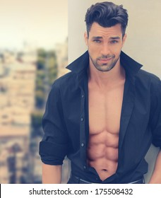Sexy male fashion model with open shirt and nice abs