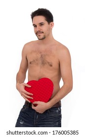 Sexy male with heart shape box over white background