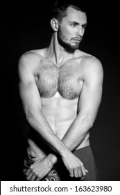 Sexy male model. Black-and-white photo