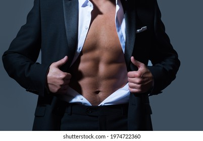 Sexy male torso in suit. Business fashion look. Man undress suit. Abs, six pack, workout.