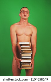Sexy man back to school. Sensual male. Hot guy. Passionate concept. Adult. Passion. Many books. Back to school. Funny photo. Dream. Male glasses. Green background. Brutla sexy man. Handsome. Sex.