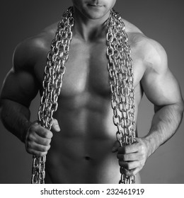 Sexy man body with chain in black and white, seduction