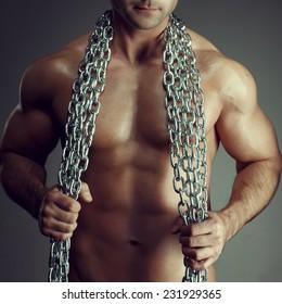 Sexy man body with chain closeup, seduction