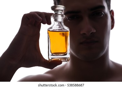 Sexy man with bottle of perfume