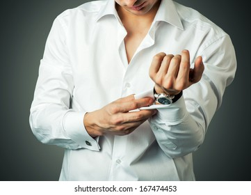Sexy man buttons cuff-link on French cuffs sleeves luxury white shirt