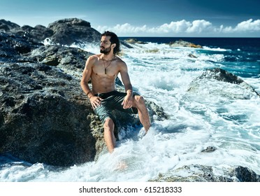 Sexy man coming from ocean
