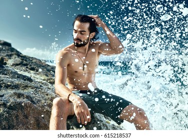 Sexy man coming from ocean. With real foam and water drops& Perfect for advertising.