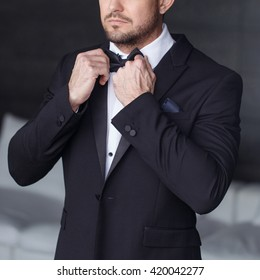 Sexy man dressing tuxedo and suit in luxury flat, closeup