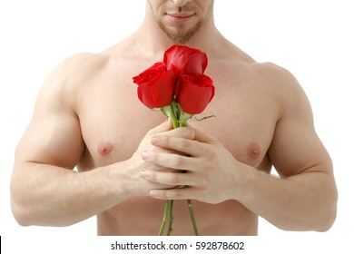 Sexy man gives a rose on a white background with a beautiful light. Isolated on white background